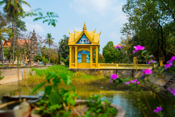 Siemreap,Cambodia.A small Golden temple by the lake
