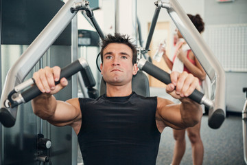 Gym: Man Concentrates While Doing Arm Workout