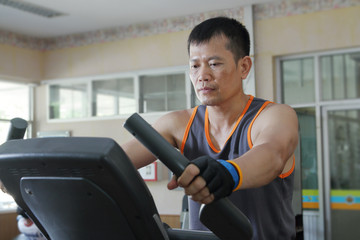 Exercising in the gym,Man walking on treadmill.