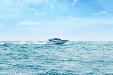 Big and luxury speedboat moving in the sea. Motor vessel.