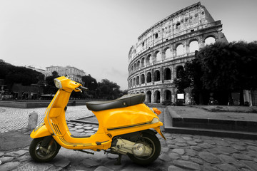 Yellow vintage scooter on the background of Coliseum