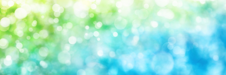 Defocused highlights in green and blue, panorama format