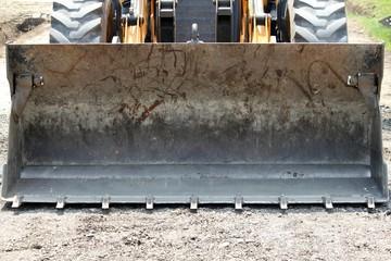 closeup shot of a bulldozer standing on road construction