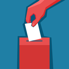 Hand puts ballot in the ballot box