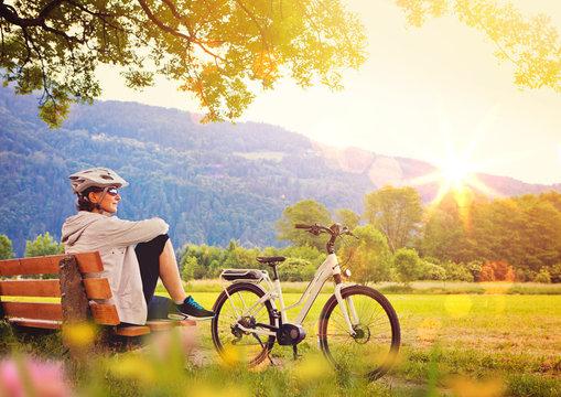woman relaxing beside her e-bike - e-power 05