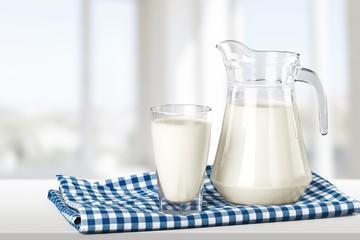 Milk, glass, tablecloth.