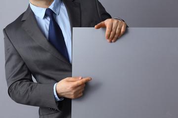 Businessman holding a blank  board