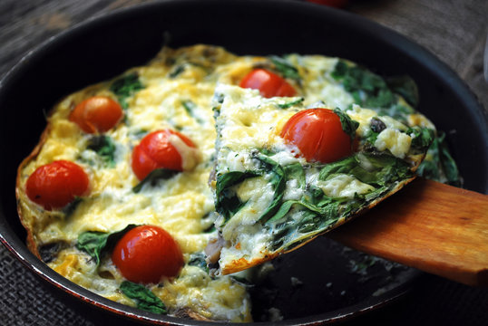 Frittata with cherry tomatoes, cheese and spinach