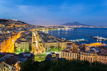 Fotobehang Napels Naples, Italy, view of the bay and Vesuvius Volcano by night, from Posillipo