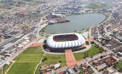 Zelfklevend Fotobehang Stadion Arial View of Soccer Stadium and Lake