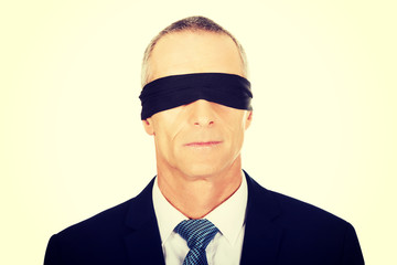 Businessman with band on eyes