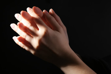 Woman praying in darkness