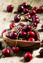 Fresh  cherries in a wooden bowl in the shape of a heart, select