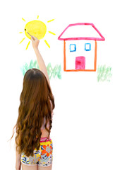 little girl draws paints the house