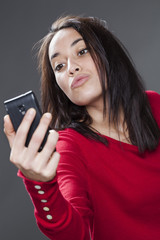 multi-ethnic 20s woman pouting for her selfie portrait on mobile phone