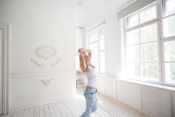 Happy girl in the morning, looks in window