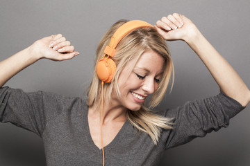 pretty young woman enjoying good vibes on headphones