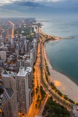 Fotomurales - Chicago skyline and lake Michigan at sunset