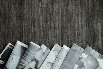 Black-and-white photos on the old wood background