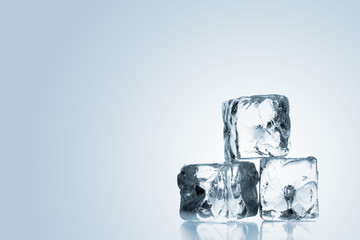 Three ice cubes stacked over blue gradient background
