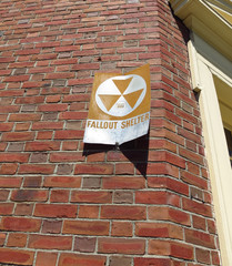 Fallout Shelter Sign on Brick Building