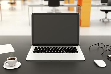 Blank laptop on a modern workplace