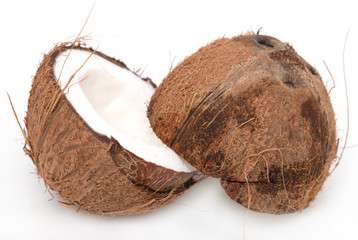 halves of coconut on white background