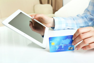 Female hands with tablet and credit card as online shopping concept