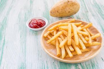 french fries on a wooden background