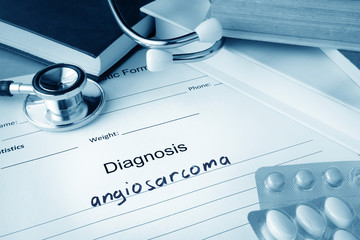 Diagnostic form with diagnosis angiosarcoma and pills.