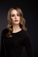 Portrait of young girl with makeup and retouch on dark backgroun