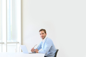 businessman in modern office working on laptop