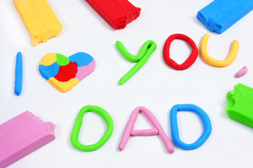 text I love you dad made from modeling clay
