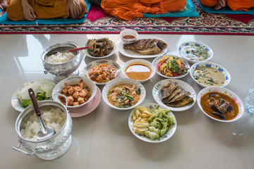 food and drink for monks in traditional religious ceremony in a temple in Thailand.