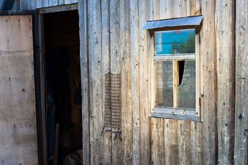 Opened door of a wooden barn