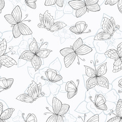 Vector seamless pattern with hand drawn butterflies and flowers on white background. Background for use in design, web site, packing, textile, fabric