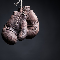 Wall Mural - vintage boxing gloves on a black background