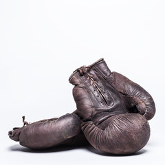 Wall Mural - vintage boxing gloves on a  white background