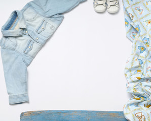 horizontal frame of jeans stuff and sneakers for baby boy on whi
