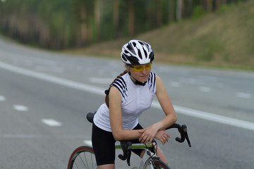 cyclist on the road, the girl with bike