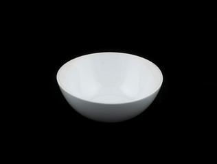 white bowl on black background