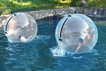 Children Playing in the water ball