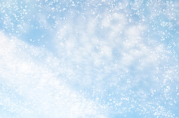 Falling snowflakes on  blue background