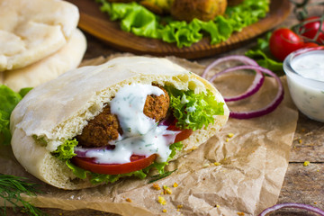 falafel with fresh vegetables in pita bread