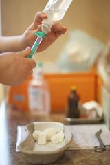 Nurse hands preparing intravenous drip