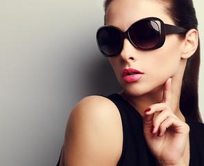 Elegant chic female model in fashion sunglasses posing