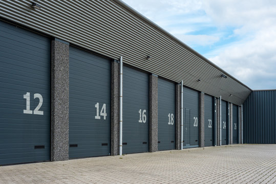 Row of gray numbered business units or garages