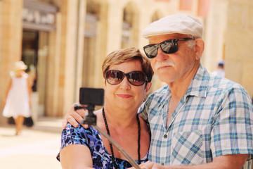 Happy loving senior couple enjoying vacation together