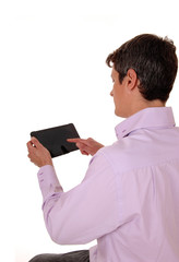 Man with tablet from back.