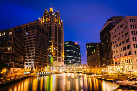 Buildings along the Milwaukee River at night, in Milwaukee, Wisc